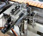 Узел скругления углов для финишной обработки углов на прямых и фасонных панелях: