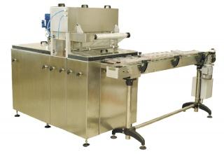 Автоматическая линия вакуумной запайки пластиковых контейнеров АДНК 39 ВЗП